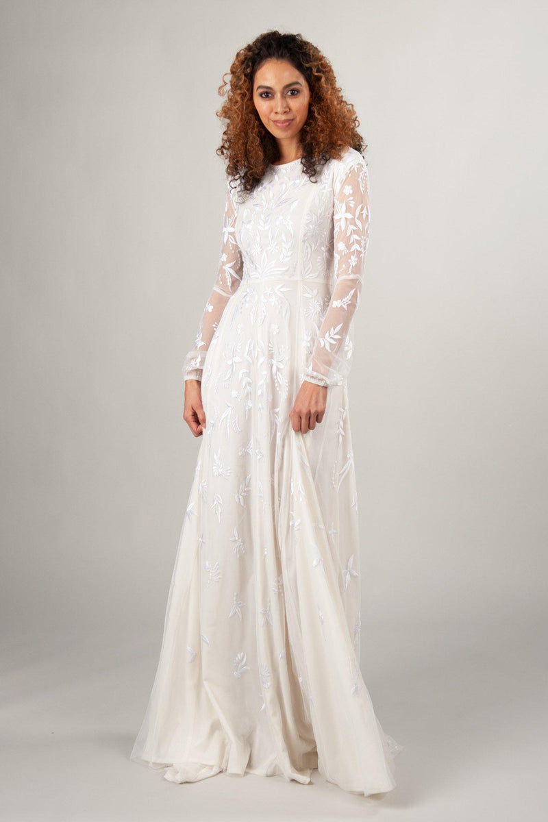 long sleeve modest wedding dresses in ivory at LatterDayBride, a wedding dress shop in SLC