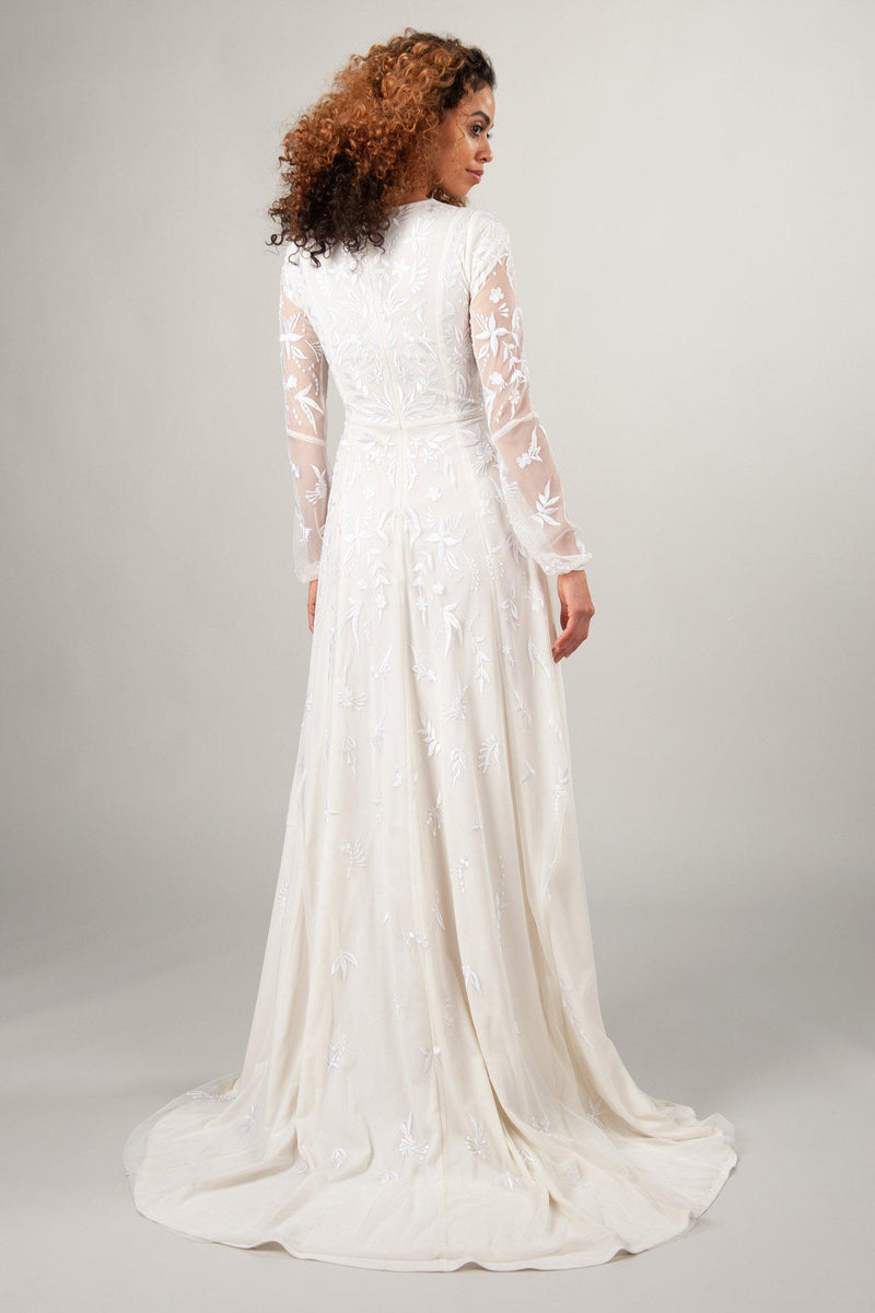 back view of the Lindir with creme, long sleeve modest wedding dress at LatterDayBride