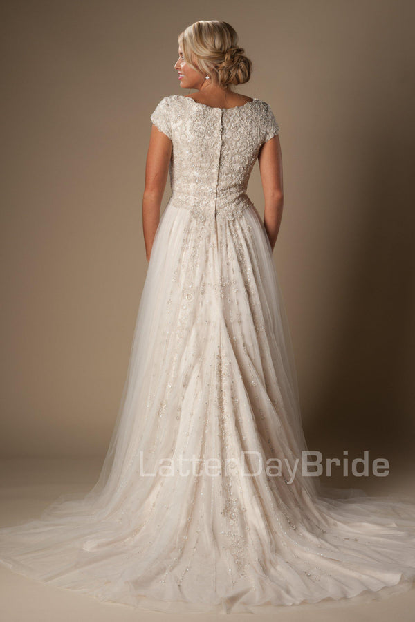 modest wedding dress features a unique bateau neckline, fully beaded bodice and delicate tulle skirt, salt lake city, back view