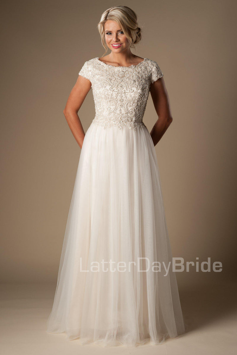 modest wedding dress features a unique bateau neckline, fully beaded bodice and delicate tulle skirt, salt lake city, front view