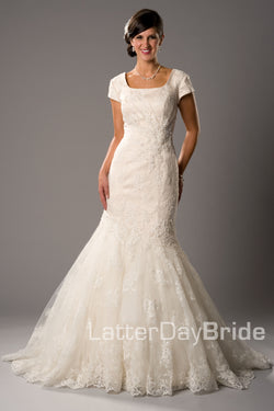 Modest wedding gown with darling lace pattern , style Esperanza, is part of the LatterDayBride Collection, a Utah bridal shop.