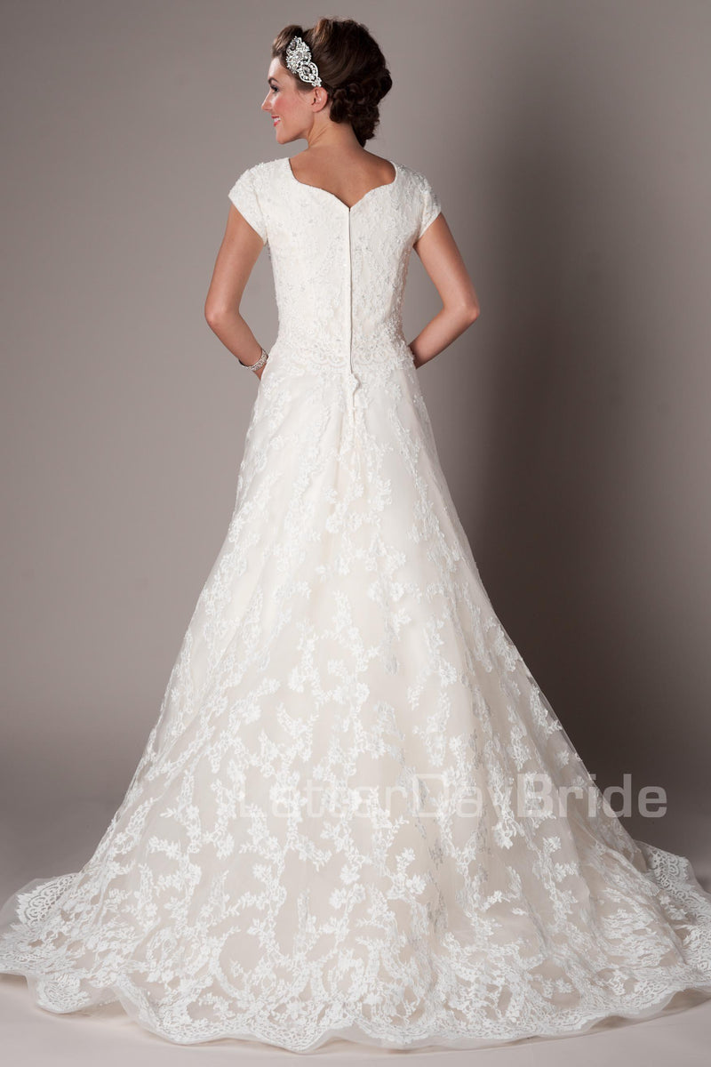 A-line skirt with a Princess sweetheart neckline, modest utah wedding dresses, back view