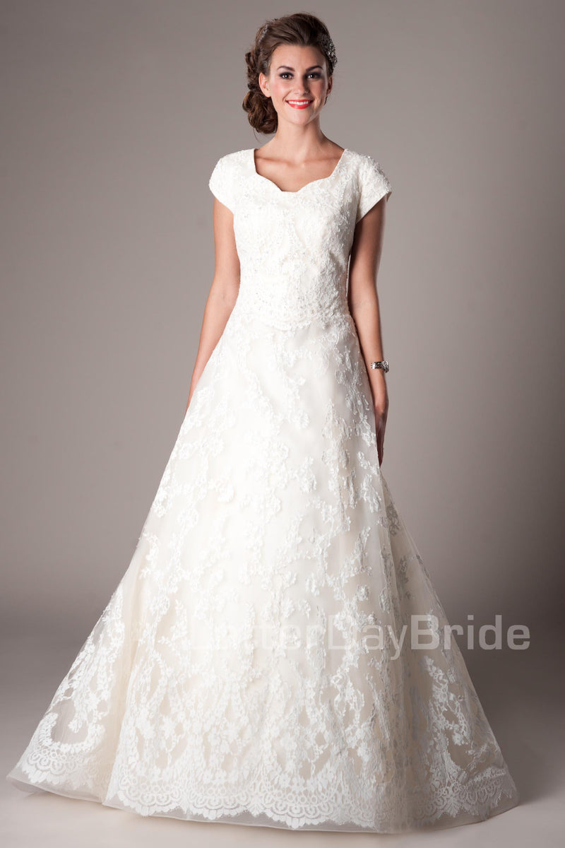 A-line skirt with a Princess sweetheart neckline, modest utah wedding dresses, front view