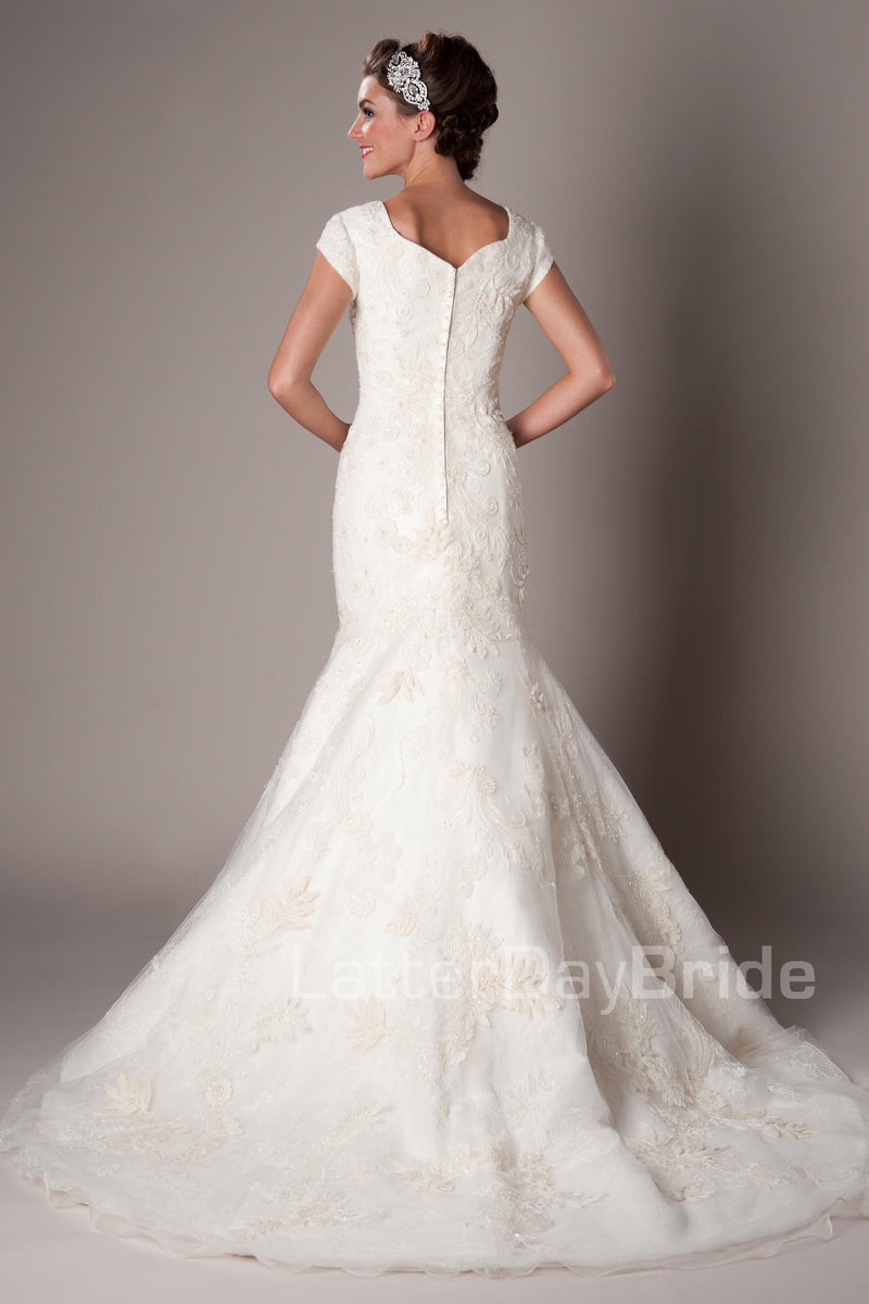 full A-line skirt with a Princess sweetheart neckline, modest utah wedding gowns, back view