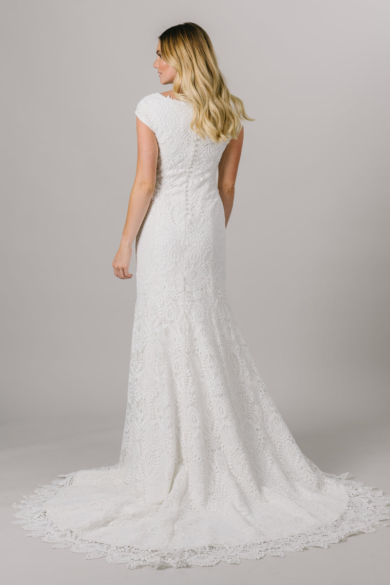 This fitted modest wedding dress features a full, thick lace pattern with dainty little sleeves and a gorgeous neckline somewhere between a sweetheart and v-neckline.   Style Love: This dress is part of our brand new, exclusive LatterDayBride wedding dress collection. From a bridal shop in Salt Lake City called LatterDayBride.