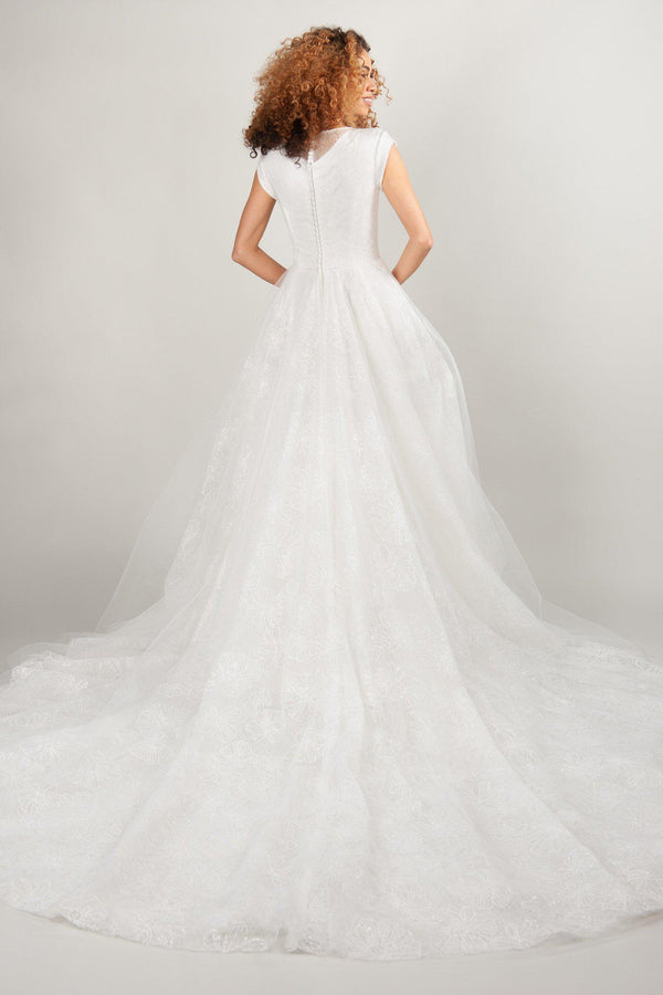 modest wedding dresses in ivory with sparkle, at LatterDayBride, an dress shop in Salt Lake City
