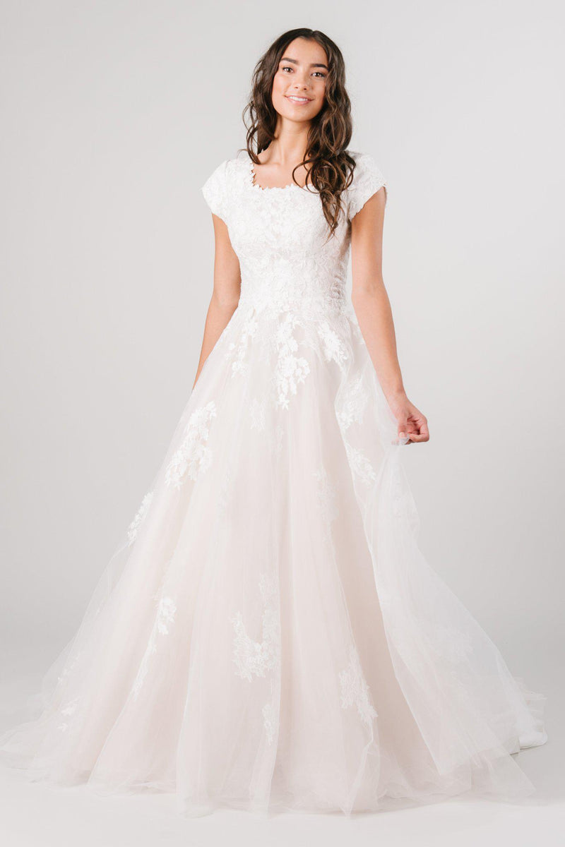 Modest ballgown with lace detailing. This modest wedding dress is from LatterDayBride, a modest wedding dress shop in downtown salt lake city, utah.