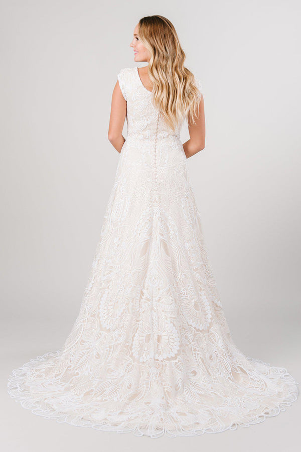 Back view of a modest wedding dress with full lace in a beautiful detailing! Modest wedding dress from LatterDayBride a bridal store in Salt Lake City, Utah.