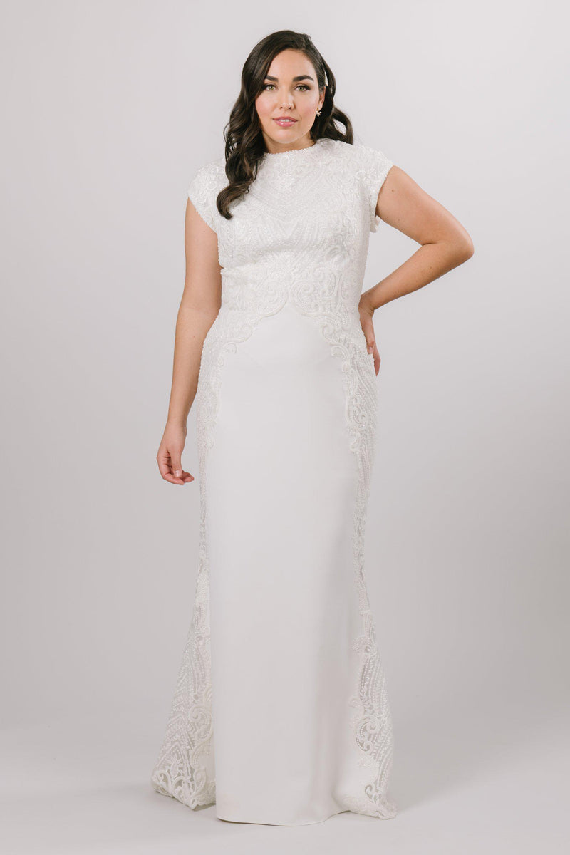Modest Wedding dress with sparkle lace along the sides of the dress. Small train and capped sleeves.