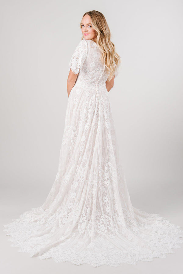 Back view boho lace modest wedding dress with flutter sleeves. This modest wedding dress is from LatterDayBride, a bridal shop located in downtown Salt Lake City, Utah.
