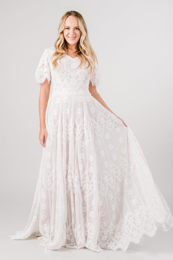 Front view boho lace modest wedding dress with flutter sleeves. This modest wedding dress is from LatterDayBride, a bridal shop located in downtown Salt Lake City, Utah.