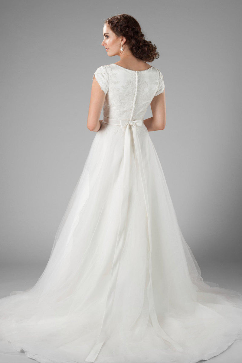 The delicate petal sleeves, the wide boat neckline and the flattering cinched waist, modest wedding dresses salt lake, back view