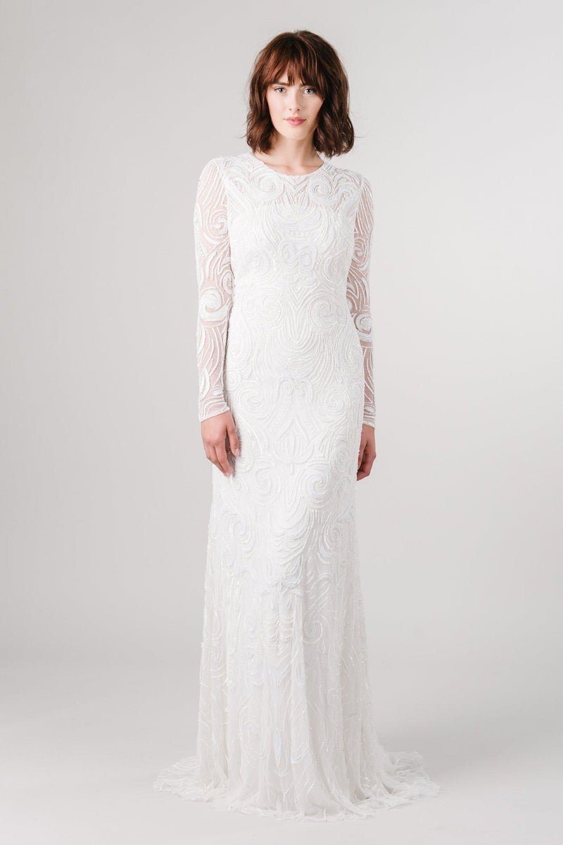 Beaded long sleeve modest wedding dress from LatterDayBride, a bridal shop in Salt Lake City, Utah.