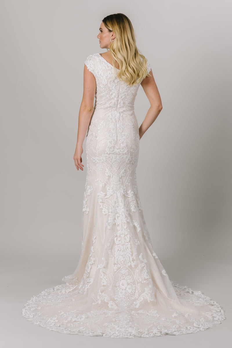 This fit-and-flare, modest wedding dress features a flattering V-neckline and a double lace design that creates amazing dimension.  Available in Ivory/Ivory. From a bridal shop called LatterDayBride in Salt Lake City.