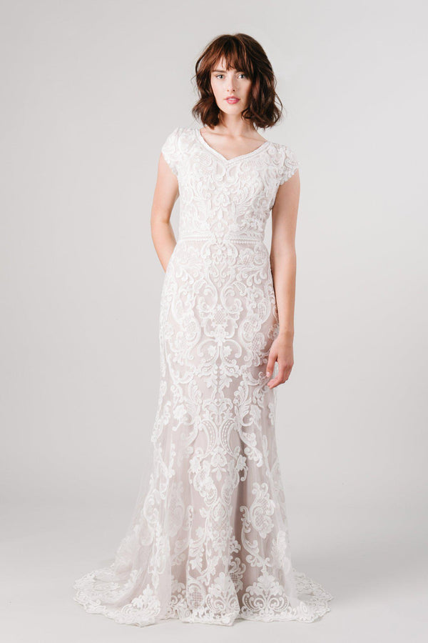 Fitted lace modest wedding dress from LatterDayBride, a modest bridal shop in Downtown Salt Lake City, Utah.