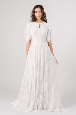 Lace modest wedding dress with flutter sleeves from LatterDayBride, a modest wedding dress shop in Salt Lake City, Utah.