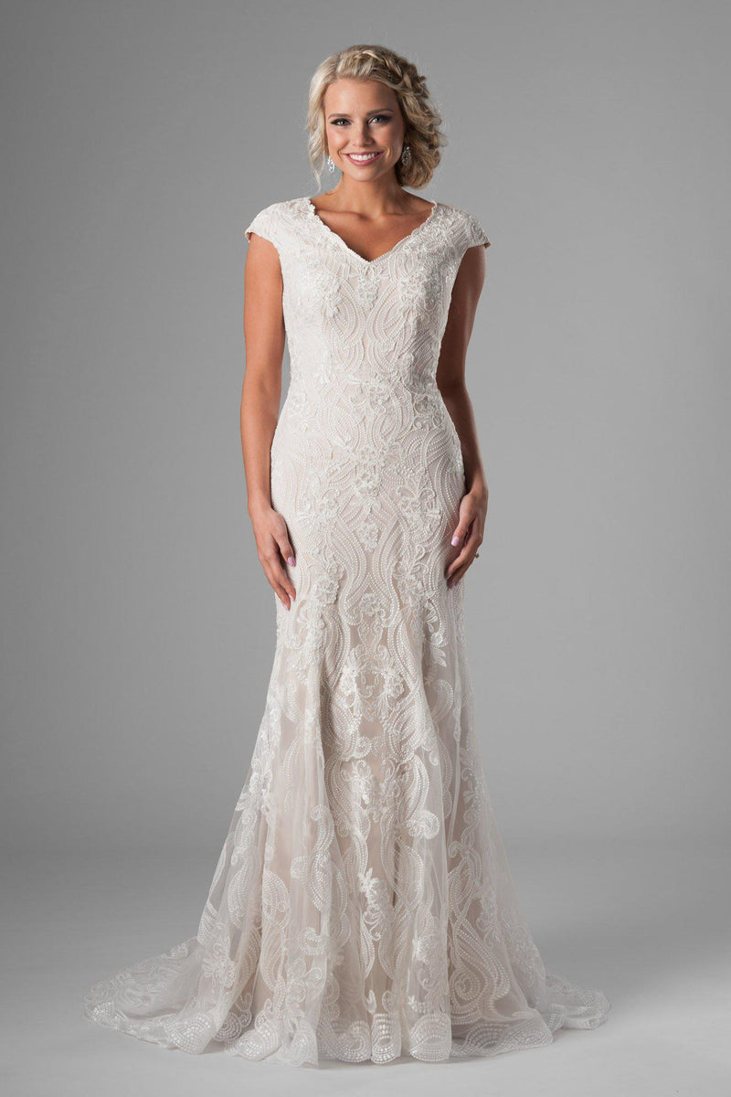 Stunning modest mermaid gown, style Havana, is part of the Wedding Collection of LatterDayBride, a Salt Lake City bridal store.