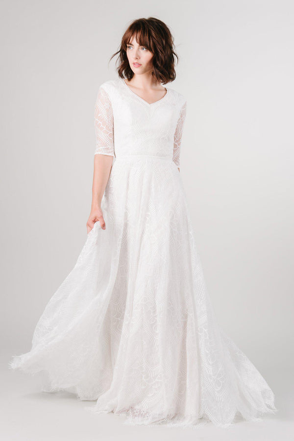 Modest lace wedding dress with long sleeves from LatterDayBride, a bridal shop in Downtown Salt Lake City, Utah.