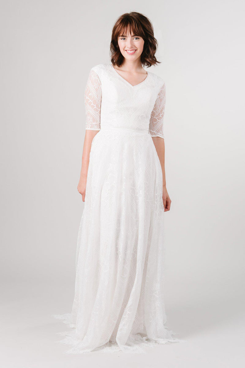 Front view of a modest wedding ballgown with lace details from LatterDayBride, a modest wedding dress shop in Salt Lake City, Utah