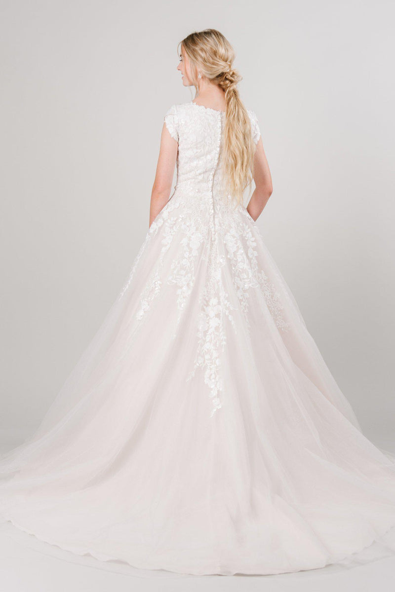 Modest ballgown with lace and sparkles from LatterDayBride, a modest wedding dress shop in Salt Lake City, Utah.