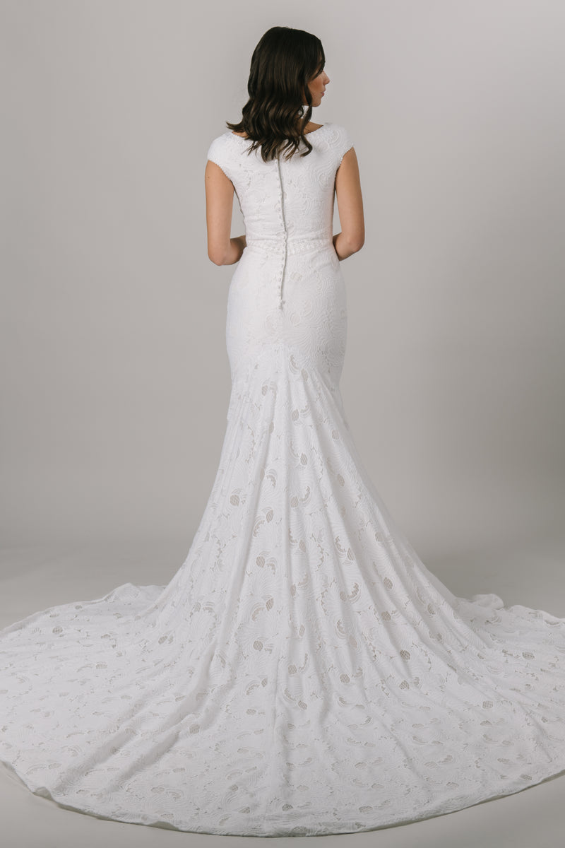 Fall in love with lace all over again! This stunning modest wedding dress features a sophisticated lace pattern, flattering fit-and-flare silhouette and an accentuated waistband that everyone loves!   Shown in Sand/Ivory. From a bridal shop called LatterDayBride in downtown Salt Lake City.