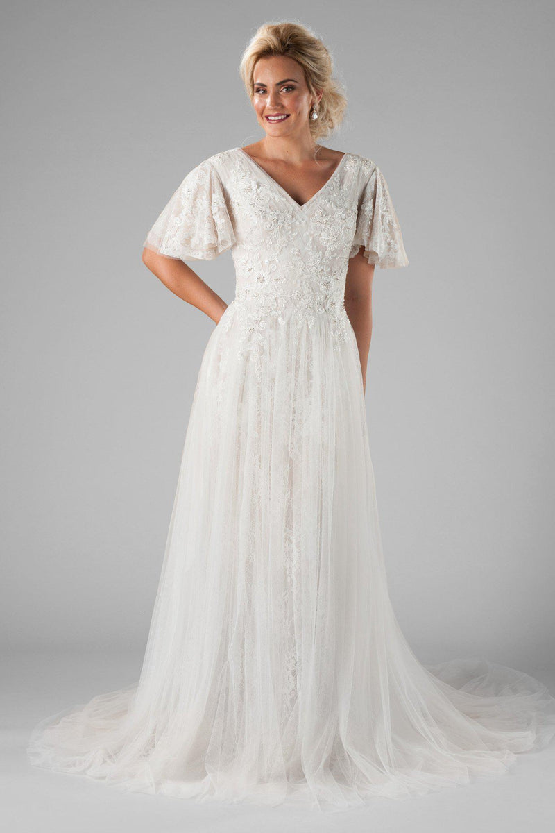 Modest wedding dress with lace and beading, style Karisma, is part of the Wedding Collection of LatterDayBride, a Salt Lake City bridal shop.