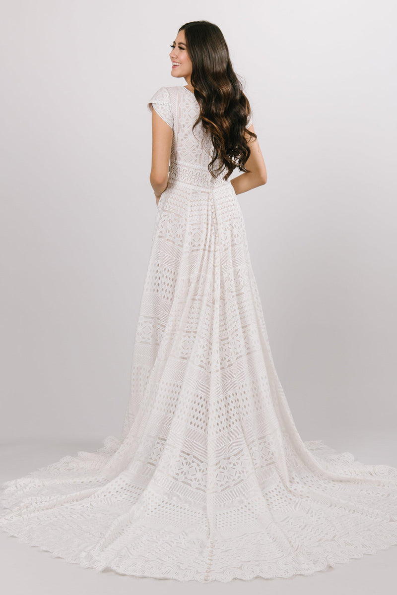 Modest all over lace wedding dress with a soft aline look and cap sleeves at bridal shop in salt lake city utah
