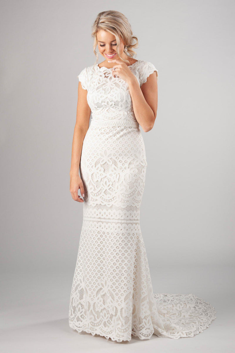 Boat neckline with delicate scalloped sleeves, style Luciana, is part of the Wedding Collection of LatterDayBride, a Salt Lake City bridal shop.