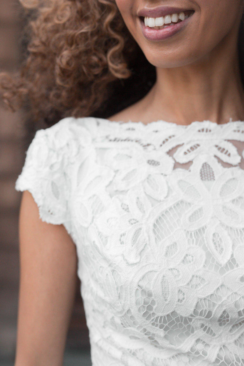 Close-up Boat neckline with delicate scalloped sleeves, style Luciana, is part of the Wedding Collection of LatterDayBride, a Salt Lake City bridal shop.