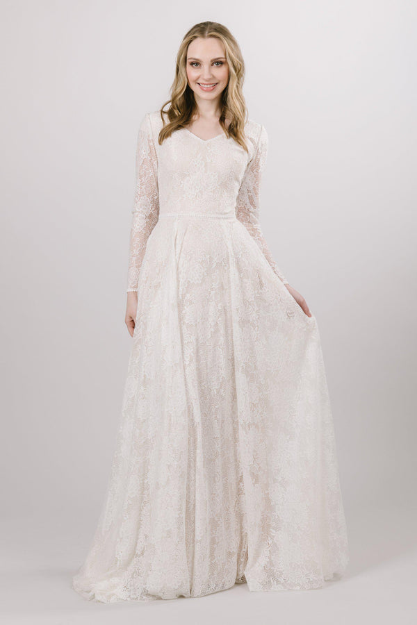 Modest Lace wedding dress with long, illusion laced sleeves from bridal shop in Salt lake city utah