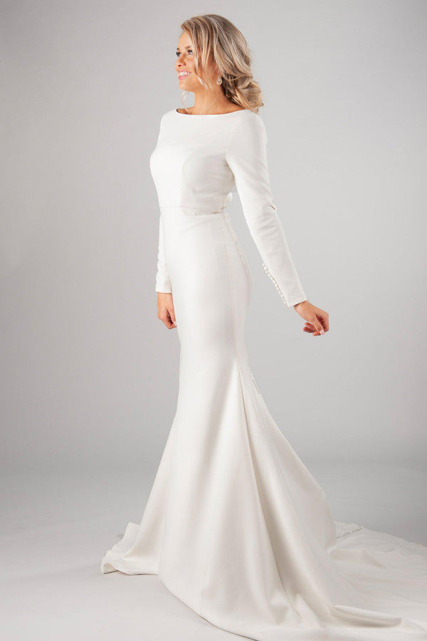 Modest long sleeve bridal gown, style Markella, is part of the Wedding Collection of LatterDayBride, a Salt Lake City bridal shop.