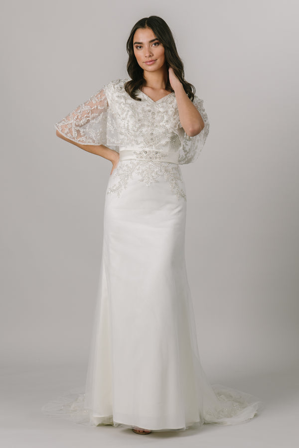 The front of a beaded A-line wedding dress with beaded flutter sleeves, from a bridal shop in salt lake city, utah.