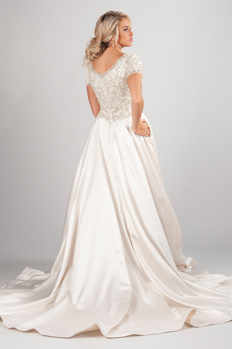 scoop neckline and fully beaded bodice offer the perfect backdrop for that lush satin skirt, modest utah wedding dresses, back view