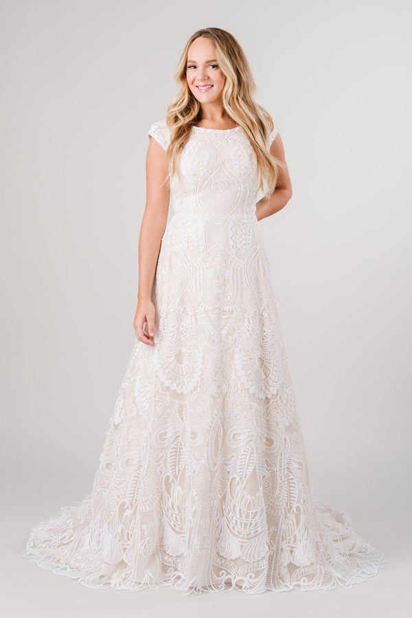 Modest wedding dress with full lace in a beautiful detailing! Modest wedding dress from LatterDayBride a bridal store in Salt Lake City, Utah.