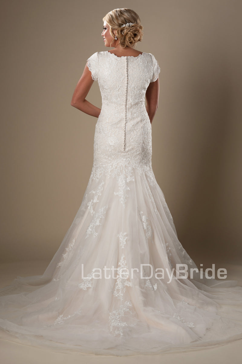 This darling modest bridal gown features a subtle splash of sequins decorating a soft lace and mermaid silhouette, modest wedding dresses, salt lake city, back view