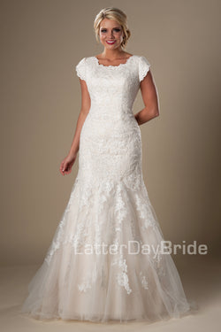 This darling modest bridal gown features a subtle splash of sequins decorating a soft lace and mermaid silhouette, modest wedding dresses, salt lake city, front view