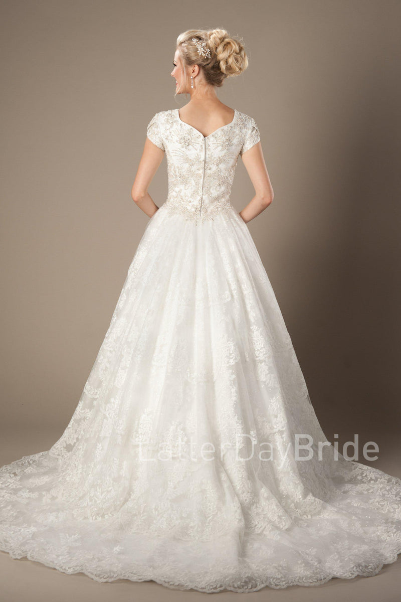 modest bridal dress features a lovely sweetheart neckline and a dazzling beaded bodice complimented by a full skirt with tiered lace, modest wedding gown salt lake city, back view