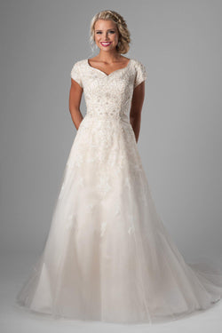 3c0414aa2892c modest wedding gown. We love the bedazzled bodice, changing to soft flowing  lace on