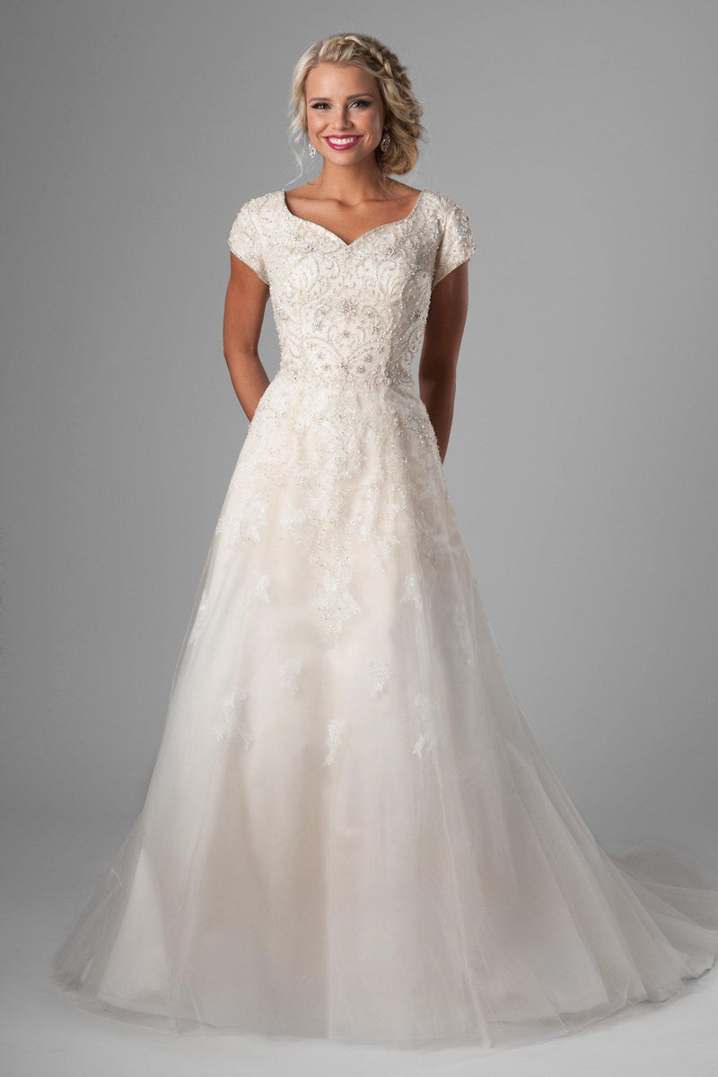 modest wedding gown. We love the bedazzled bodice, changing to soft flowing lace on the tulle skirt, salt lake city, front view