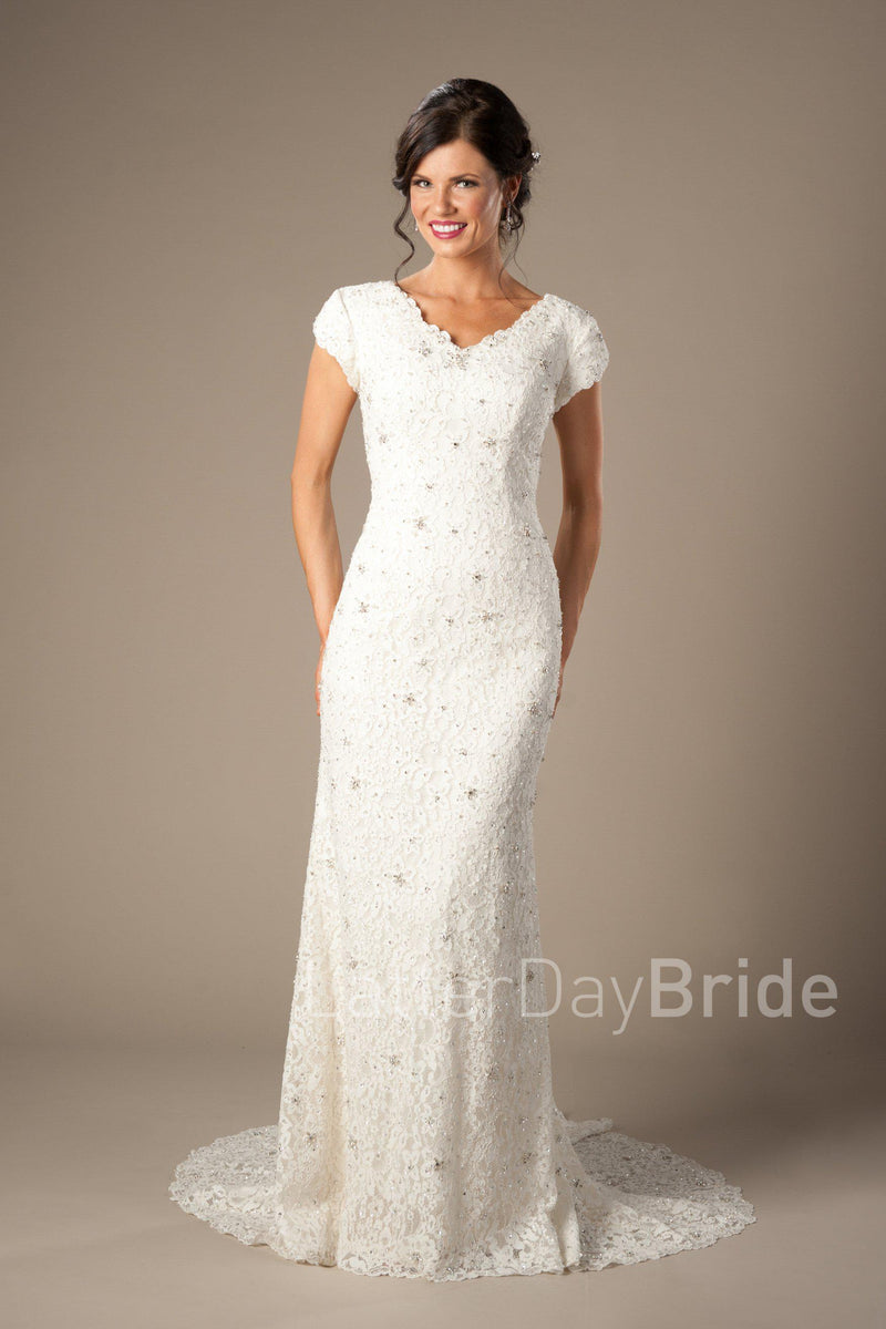 Modest full lace mermaid gown, style Embry, is part of the LatterDayBride Collection, a Utah bridal shop.