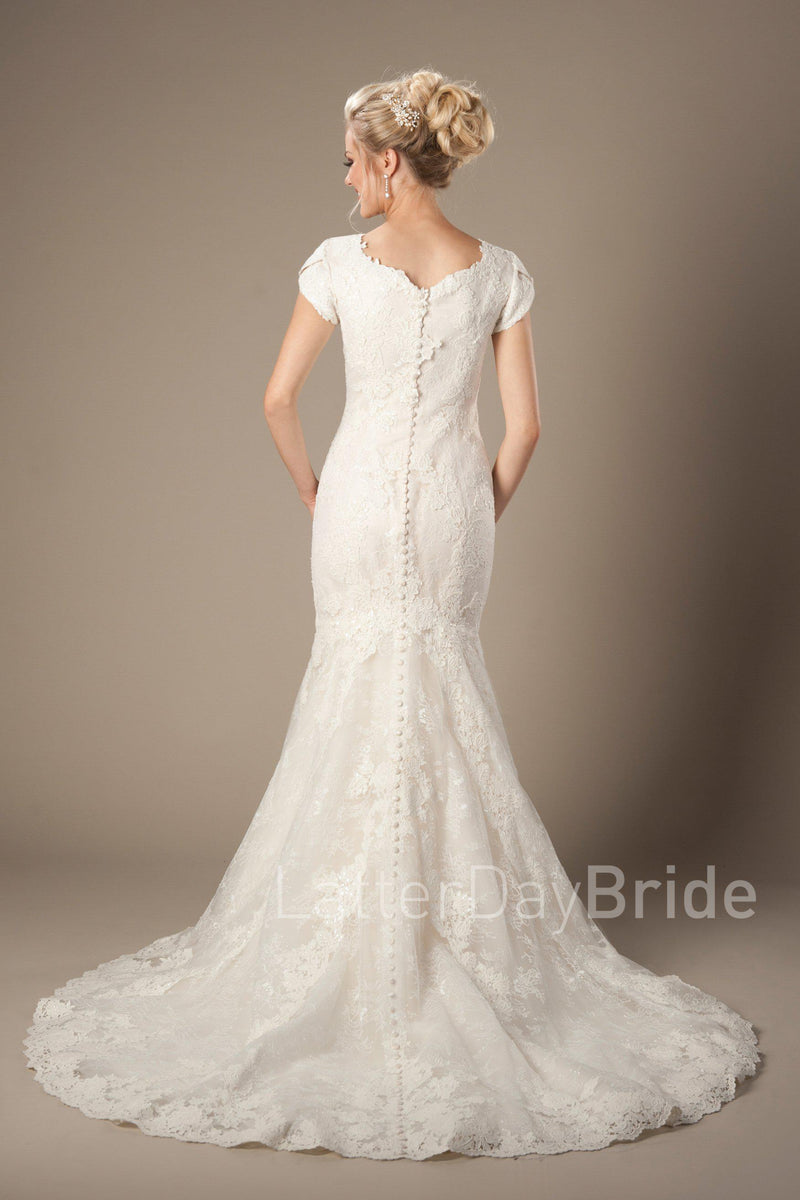 Back of Modest mermaid wedding dress with unique lace pattern, style Galloway, is part of the Wedding Collection of LatterDayBride, a Salt Lake City bridal store.