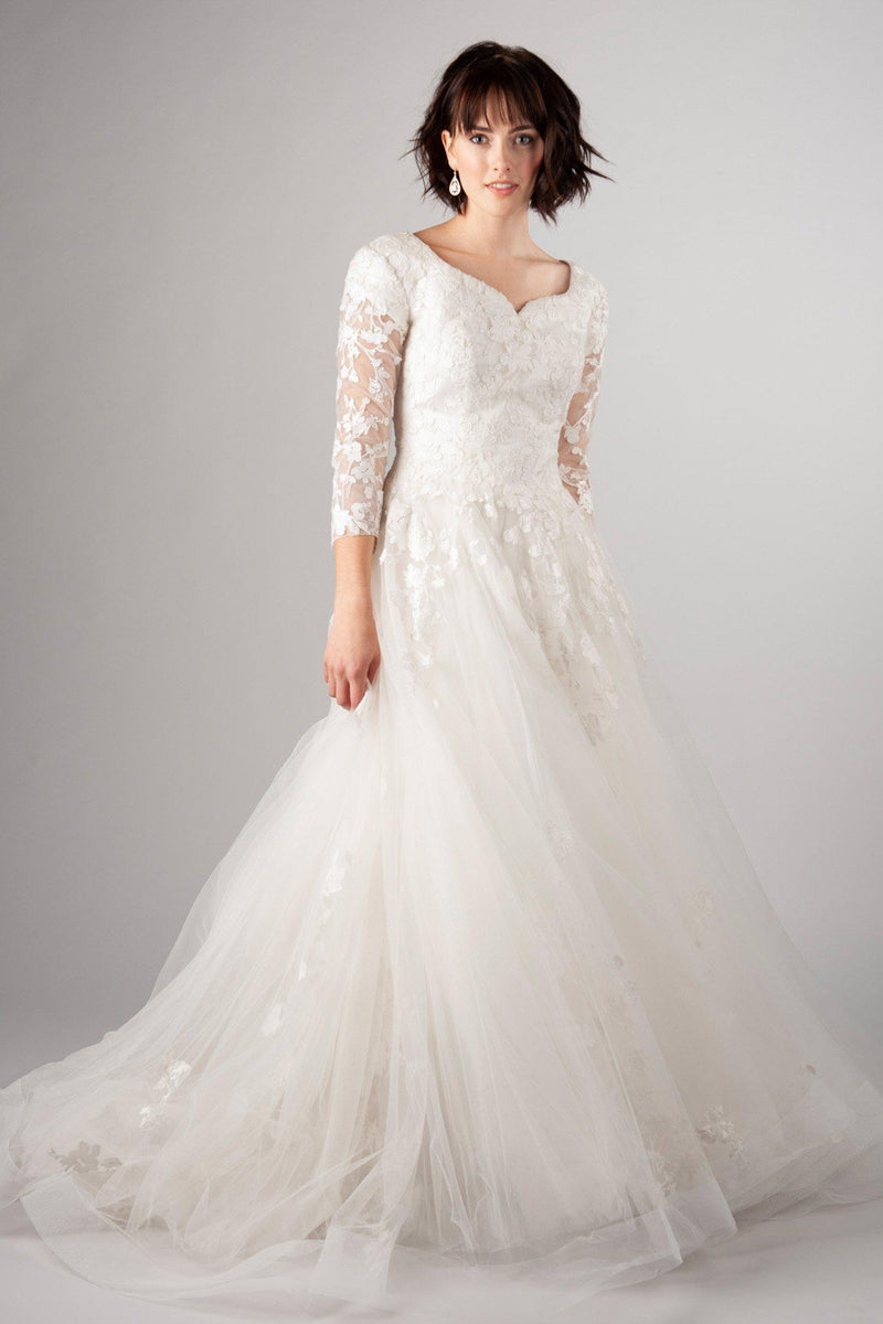 Modest lace wedding gown, style Gwenevere, is part of the Wedding Collection of LatterDayBride, a Salt Lake City bridal shop.