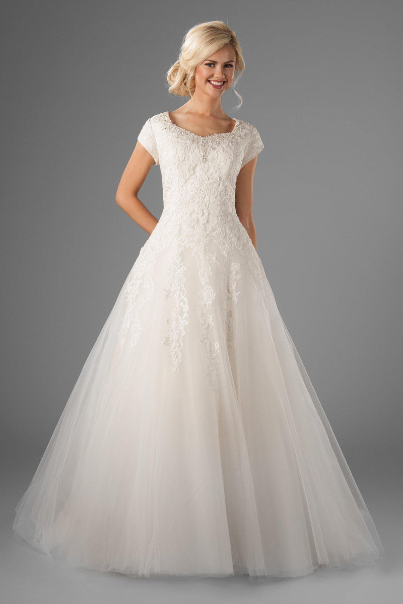 Modest ballgown wedding dress, style Juniper, is part of the Wedding Collection of LatterDayBride, a Salt Lake City bridal shop.