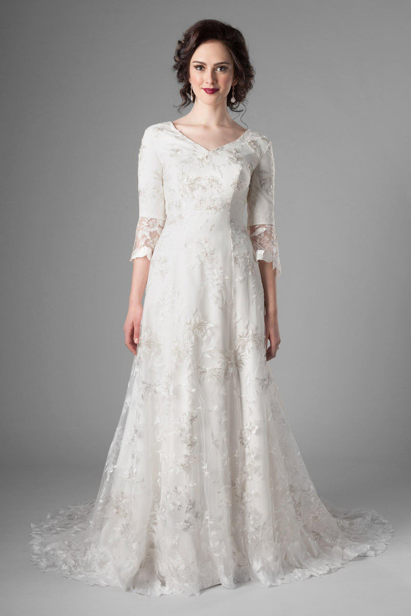 Fabulous florals with feminine shape modest wedding gown, style Rivendell, is part of the Wedding Collection of LatterDayBride, a Utah Wedding Shop.