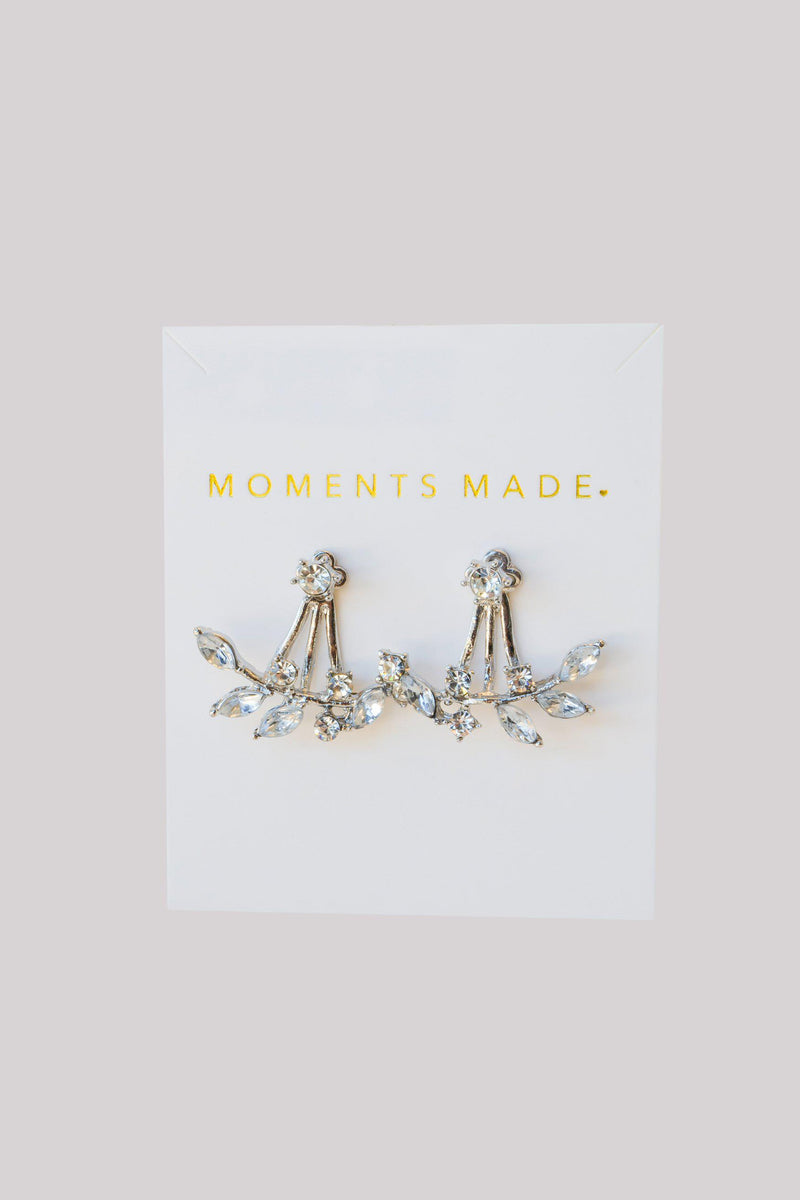 Silver ear jacket earrings embedded with crystals creating a leafy look from Salt Lake City Bridal Shop