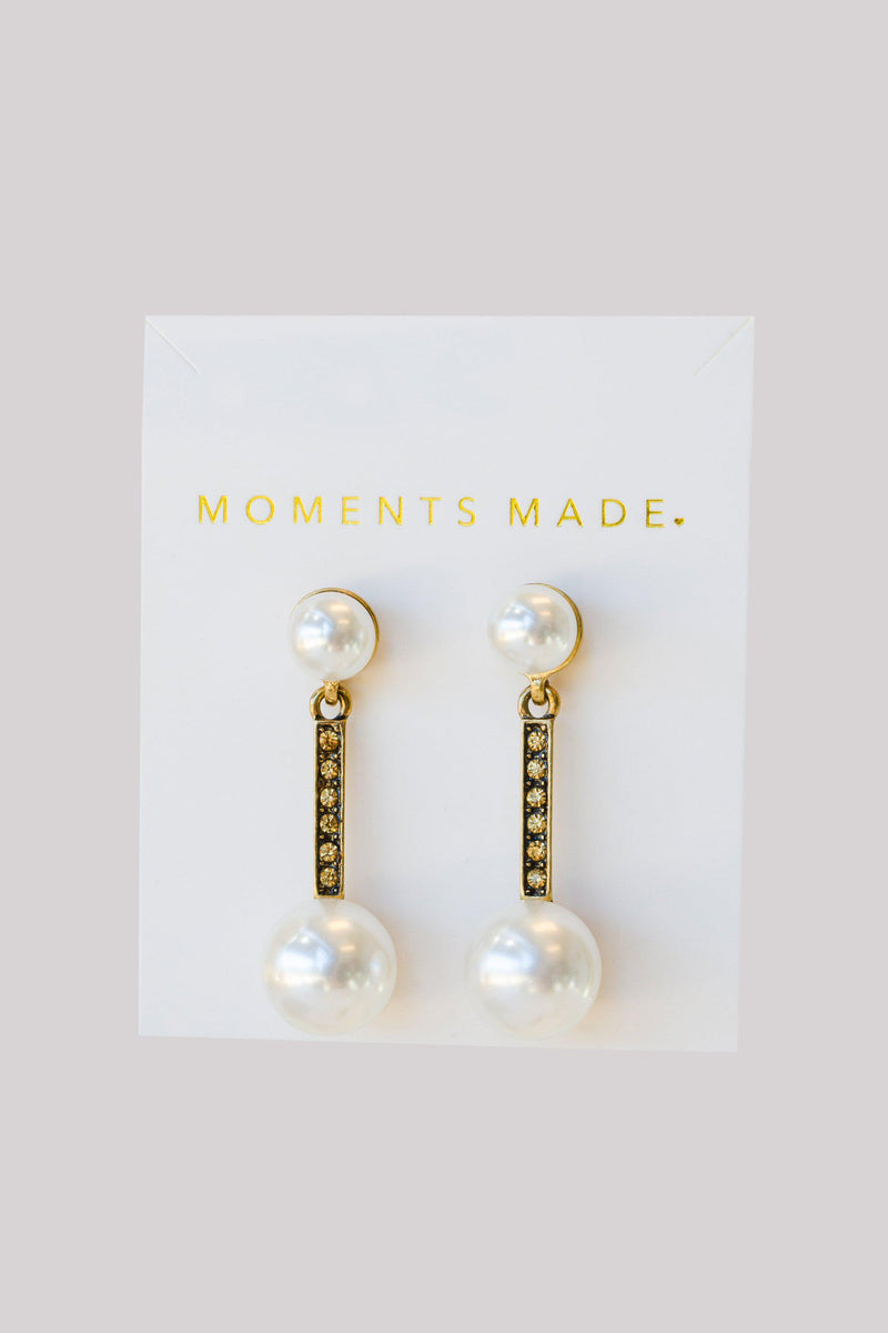 Pearl studded earrings, lined with gold dangling another larger pearl from bridal shop in salt lake city utah