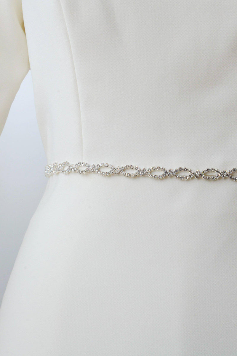 Silver metal belt with crystals encased in a circular pattern from bridal shop in salt lake city utah