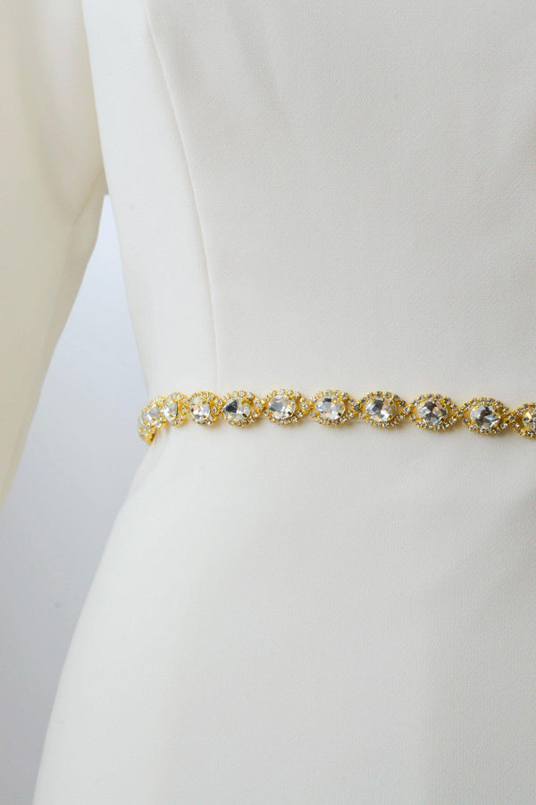 Gold metal belt accented with crystals from bridal shop in Salt Lake City Utah