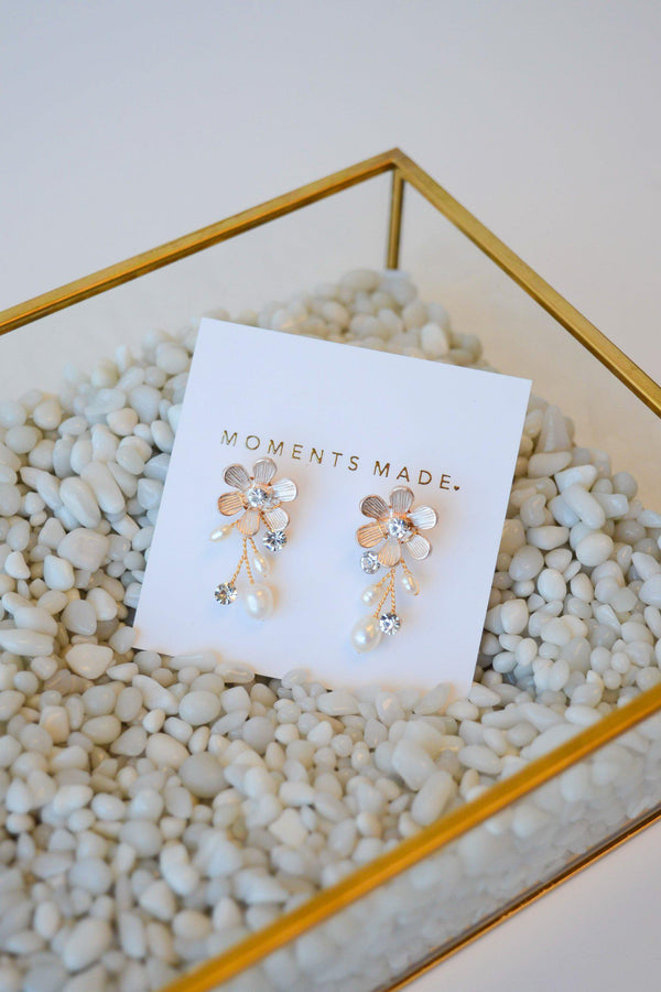 Rose gold accented flower earrings with pearl and crystals dangling from flower from bridal shop in salt lake city utah