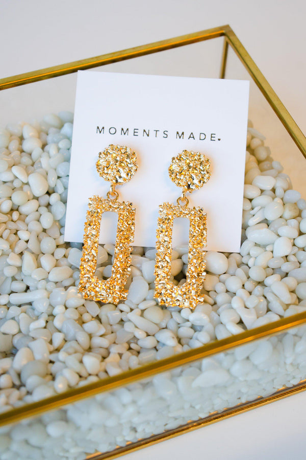 Gold and rectangular shaped earrings with floral texturing from Salt Lake City bridal shop